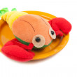 Cancer toy on an orange plate — Stock Photo