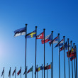 Stock Photo: International Flags against blue sky