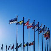 International Flags against blue sky — Stok fotoğraf