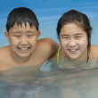 Boy and Girl in a Swimming Pool — Stock Photo