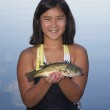 Girl Holding a Fish — Stock Photo
