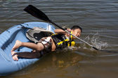 Boy Falling Off a Kayak — Stock Photo