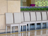A row of chairs outside of restaurant — Stock Photo