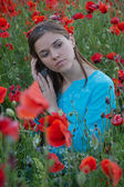 Girl and Poppies — Stock Photo