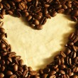 Heart shape in coffee beans — Stock Photo