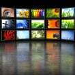 图库照片: Several TVs with images