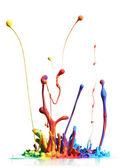 Pintura colorida espirrando isolado no branco — Foto Stock