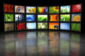 Several TVs with images — Stock Photo