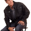 Man in jeans and leather jacket. Studio shot over white. — Stock Photo #6528087