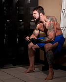 Muscular fighter in a locker room before or after a match. — Stock Photo