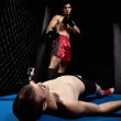 Mixed martial artists fighting - knock out — Stock Photo #6533176