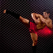 Stock Photo: Mixed martial artist posed in front of chain link