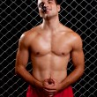 Mixed martial artist posed in front of chain link — Stock Photo #6533432