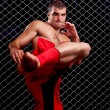Mixed martial artist posed in front of chain link — Stock Photo #6533434