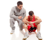 Wrestler and teammate. Studio shot over white. — Stock Photo