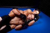 Mixed martial artists fighting - ground fighting — Stock Photo