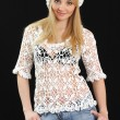 Beautiful girl in white beret and knitted jacket. — Stock Photo