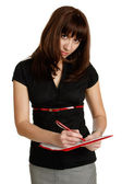 Young woman fills the document. — Stock Photo