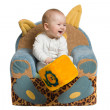 Stock Photo: Happy baby in armchair.
