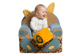 Happy baby in a armchair. — Stock Photo