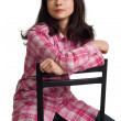 Stock Photo: Woman sits on a chair back to front.