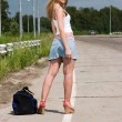 Young woman stay on the road. — Stock Photo