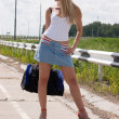 Sexy girl on highway. — Stock Photo