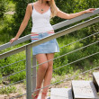 Pretty girl stands on a stairs. — Stock Photo #6671283