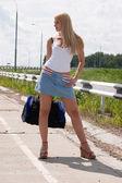 Sexy girl on highway. — Stock Photo