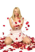 The beautiful girl with petals of roses. — Stock Photo