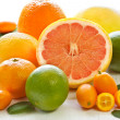 Fresh citrus fruit with leaves on a white garden board. — Stock Photo #6599301
