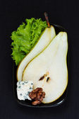 Pear with blue cheese and walnut. — Stock Photo