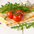Tomatoes, rucola, garlic. — Stock Photo