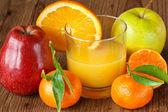 Fruit and fresh juice. — Stock Photo