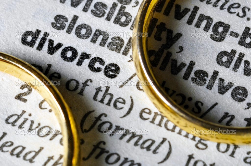 Two separate wedding rings next to the word divorce  Stock Photo #6582365
