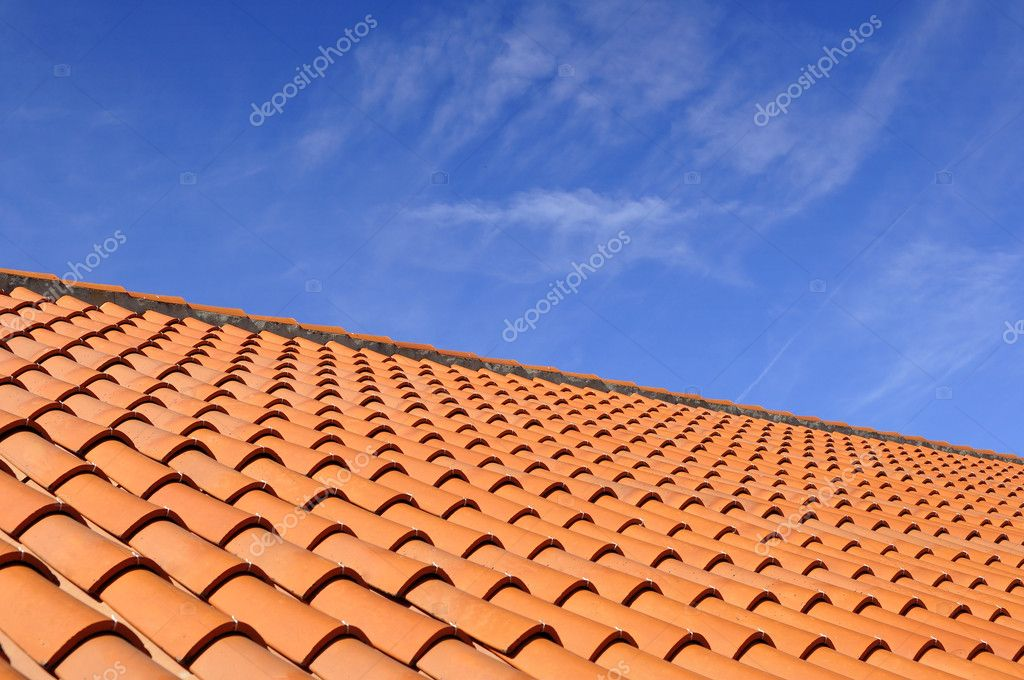 Orange roof tiles made from a ceramic material and the sky above — Stock Photo #6582525
