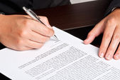 Signing a Document — Stock Photo
