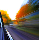 Car truck autumn abstract blur motion — Stock Photo