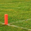 Football goal line orange marker - Stock Photo