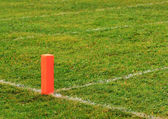 Football goal line orange marker — Stock Photo