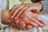 Two Generations embracing and Holding Hands - Grandmother Daughter — Stock Photo