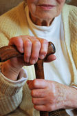 Senior woman holding her walking stick — Stock Photo