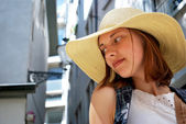 Young woman in the town with hat — Stock Photo