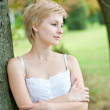 Outdoors portrait of happy young woman - Stock Photo