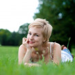 Young woman on green field - Stock Photo