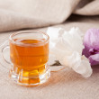 Cup with herbal tea - Stock Photo