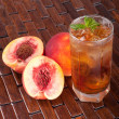 Glass of tea with peach - Stock Photo