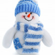 Smiling snowman toy dressed in scarf and cap — Stock Photo #6588475