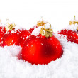 Christmas holiday decoration with white snow and red bowls — Stock fotografie