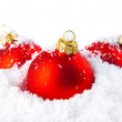 Christmas holiday decoration with white snow and red bowls — Stock Photo #6589451